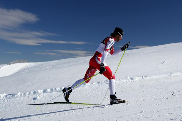 A picture of a man skiing a biathlon