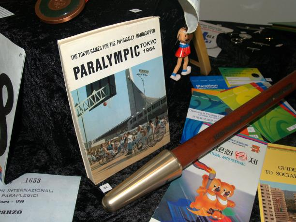 books, torch, Paralympic pins