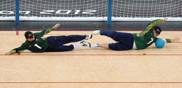Jose Roberto Ferreira de Oliveira (L) and Filippe Santos Silvestre of Brazil dive in front of the goal during the Men's Group A Goalball match between Finland and Brazil on day 1 of the London 2012 Paralympic Games