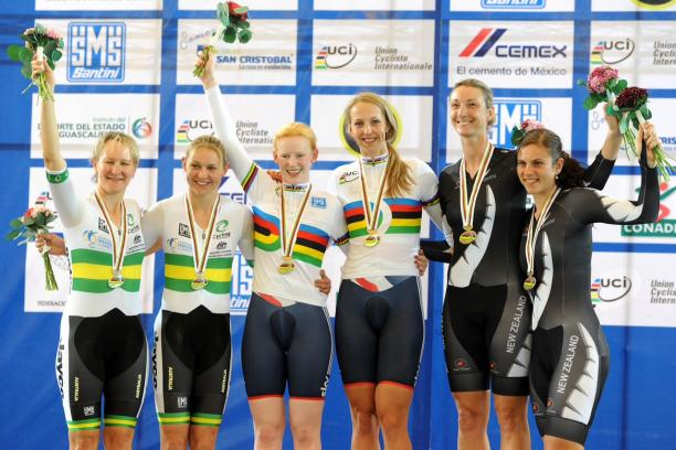 Sophie Thornhill and pilot Rachel James in their rainbow tops stand top of the podium after victory in Mexico