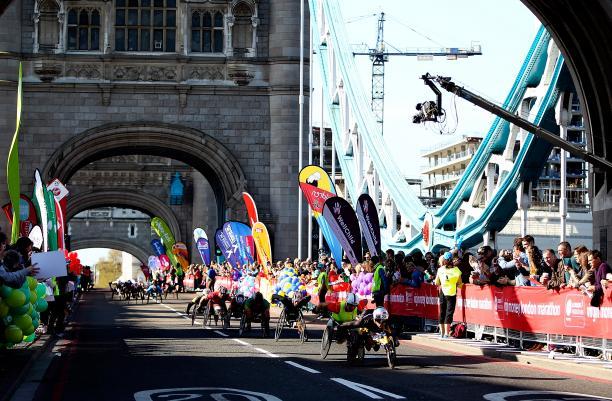 Men's wheelchair racers cross Tower Bridge in the 2014 Virgin Money London Marathon