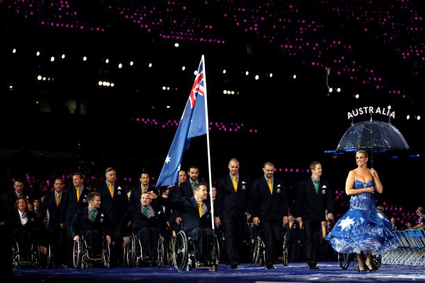An athlete carries Australia's flag through the stadium at the London 2012 Opening Ceremony.