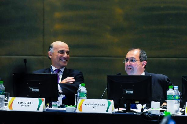 Picture of IPC Chief Executive Xavier Gonzalez and his Rio 2016 counterpart Sidney Levy dressed in suits seated behind two microphones on a table in a formal meeting.