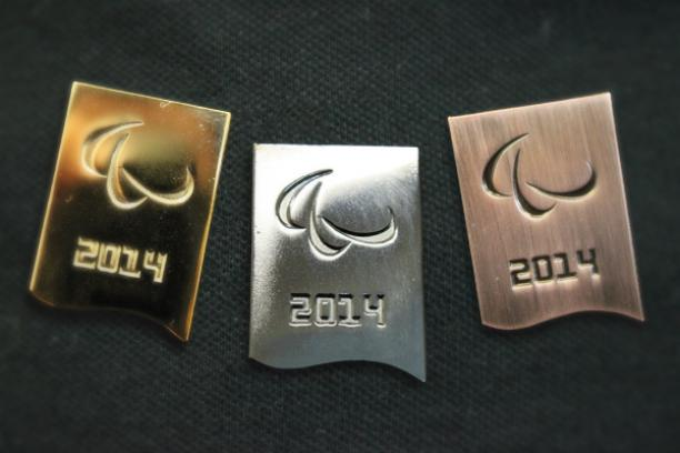 Paralympic pins in the colours gold, silver and bronze