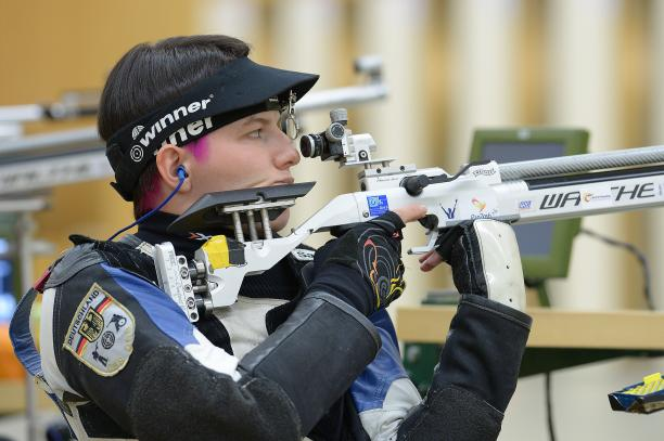A female German shooter preparing for the next shot.