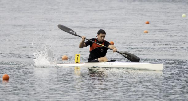 Man in canoe in action on the water