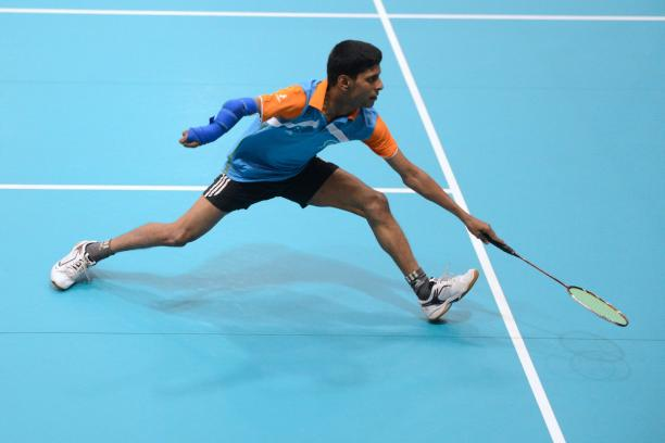 Man playing badminton