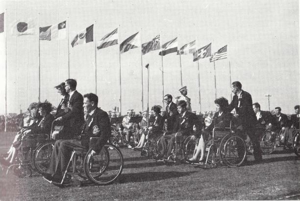 A delegation enters a stadium