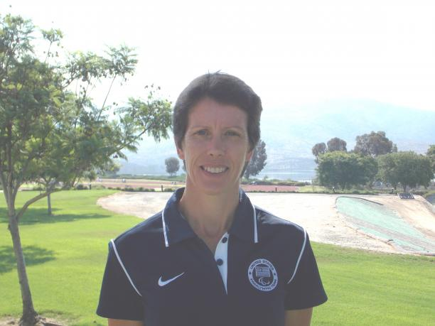 Portrait picture of a women in Team USA uniform in front of a landscape