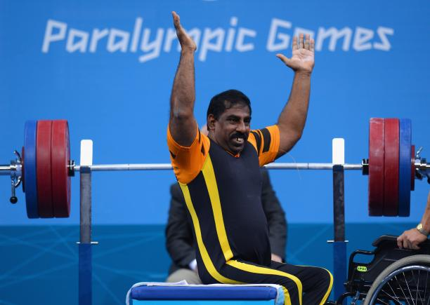 Mariappan Perumal of Malaysia waves to the crowd before he competes.