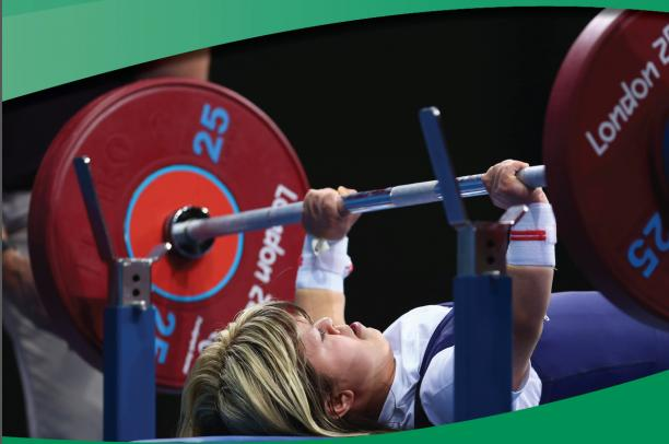 A picture of a woman competing in a powerlifitng competiton