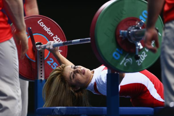 A picture of a powerlifter on a bench competing