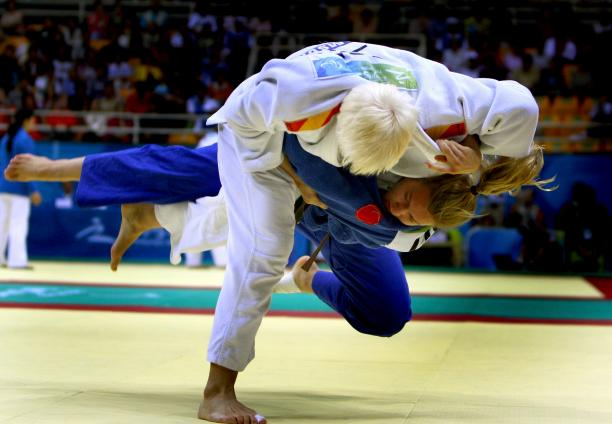 a picture of 2 athletes competing in a judo match