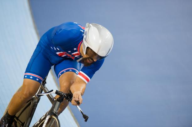 A picture of a man with one arm cycling during pursuit race.