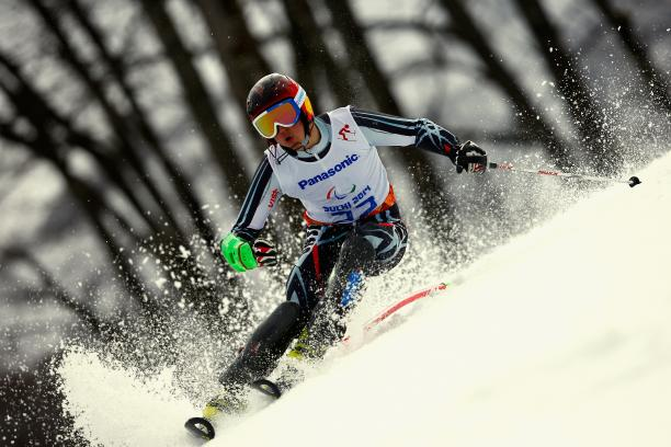Alexey Bugaev passes a slalom pole in a race in a tilted position