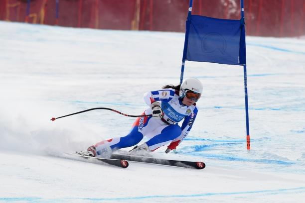 A female standing skier competes in super-G