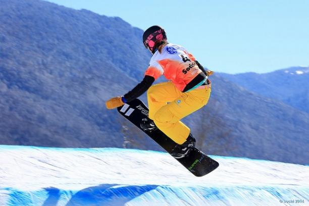 A picture of a woman doing snowboarding.