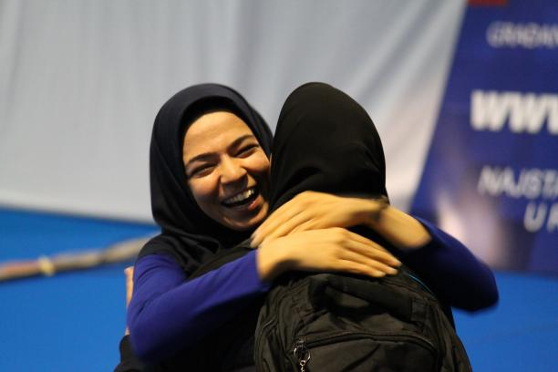 Two smiling women hugging