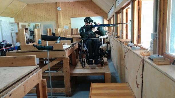 Man in wheelchair in a shooting range