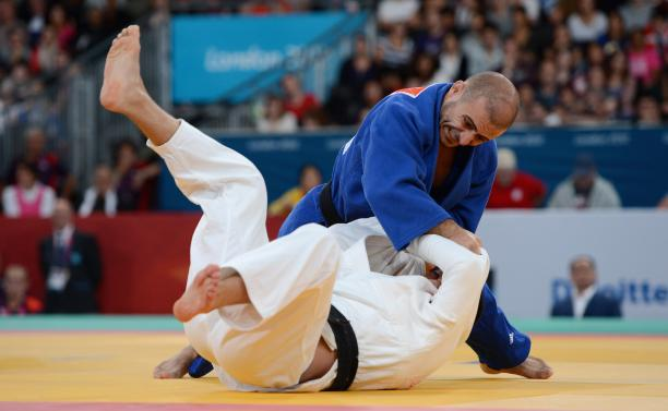 Two men practising judo