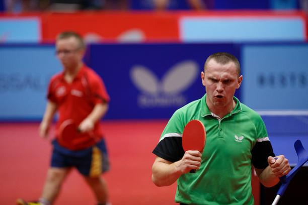 Man with table tennis racket celebrates