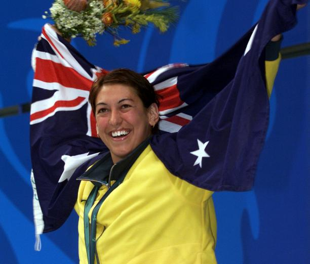 An Australian swimmer celebrates winning a gold medal at the Sydney 2000 Paralympic Games.