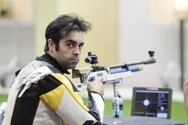 A picture of a man posing during the shooting competition