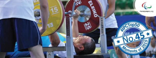 Powerlifter on a bench, raising a bar