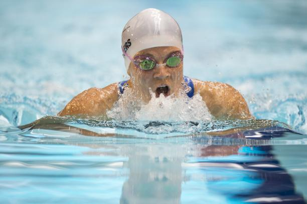 A visually impaired athlete swims