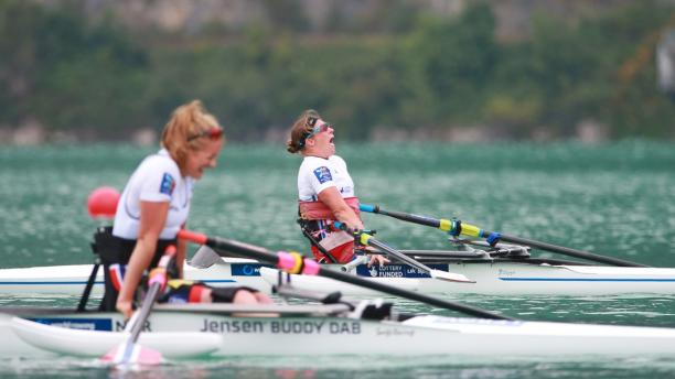 Woman in rowing boat celebrating