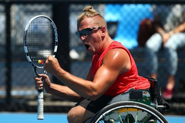 Dylan Alcott celebrates winning his quad wheelchair tennis singles match against Great Britain's Andy Lapthorne at the 2014 Australian Open.