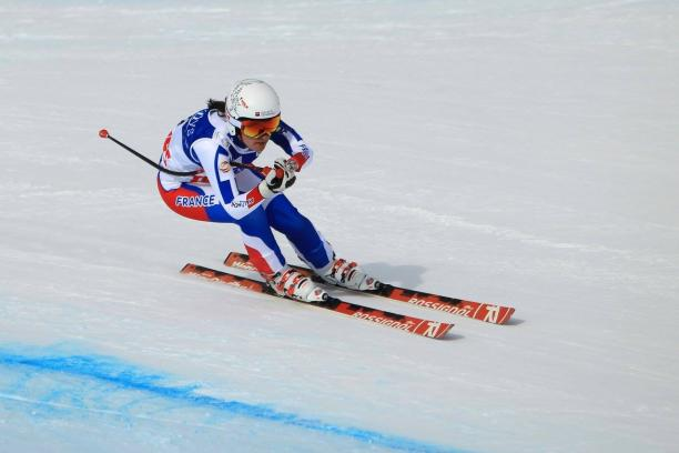 Female skier skiing downhill