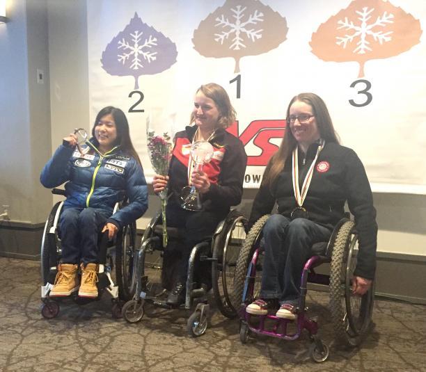 A sit-skier celebrates winning the overall super-G globe in Aspen, USA.