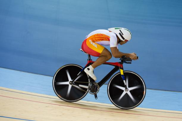 Cyclist with one leg in action on the track