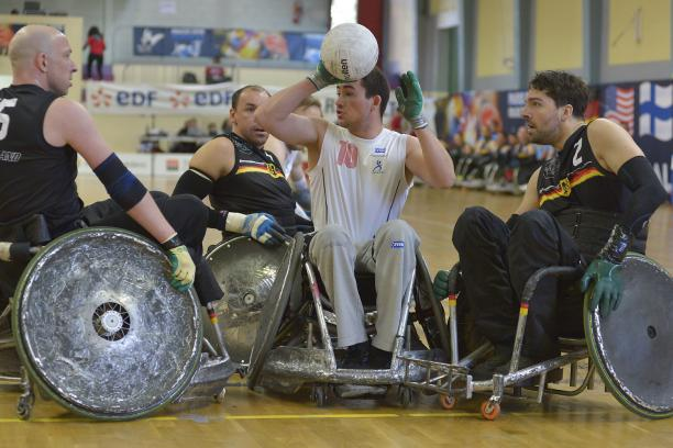 German wheelchair rugby players swarm a Danish player