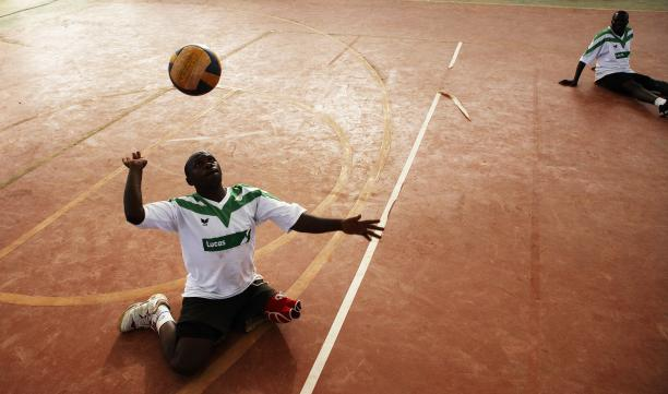 Man playing sitting volleyball