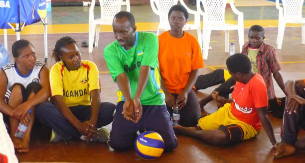 Man explaining how to play sitting volleyball