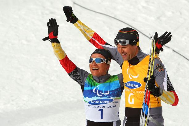 Verena Bentele and her guide Thomas Friedrich of Germany celebrate winning the Women's 3km Pursuit Visually Impaired Biathlon at the 2010 Vancouver Winter Paralympics.