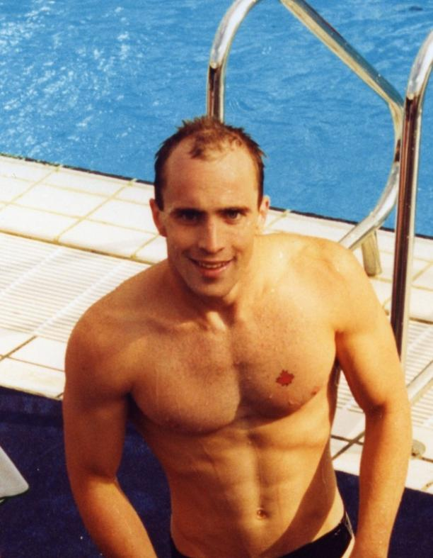 Canadian swimmer Michael Edgson stands next to the pool after competing at Barcelona 1992.