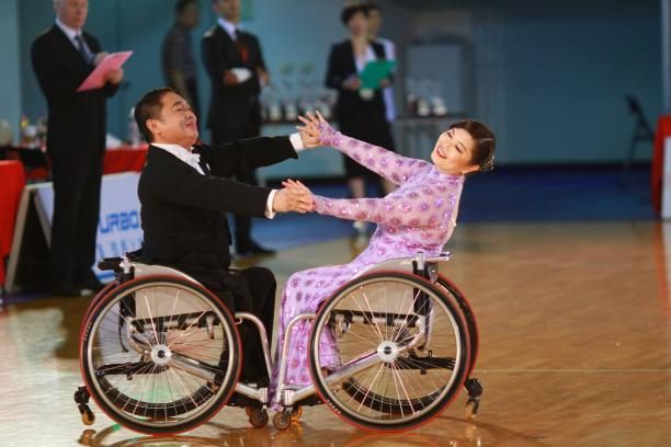 Wheelchair dancer partners competing in an event