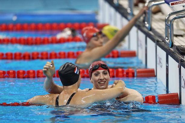 Bethany Firth (R) of Great Britain is embraced by Marlou van der Kulk (L) of the Netherlands after winning the gold medal in the Women's 100m Backstroke