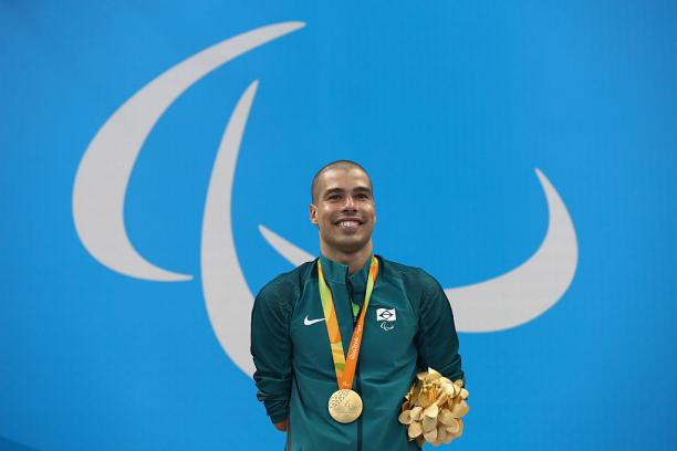 Gold medalist Daniel Dias of Brazil celebrates on the podium at the medal ceremony for the Men's 200m Freestyle - S5 Final on day 1 of the Rio 2016 Paralympic Games