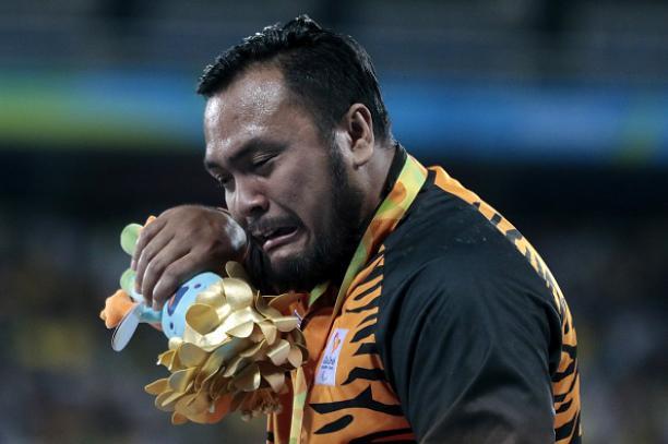 Gold medalist Muhammad Ziyad Zolkefli of Malaysia celebrate on the podium