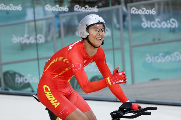 Gold medalist Zhangyu Li of China celebrates after competing in the men's 3km C1 Pursuit Final at Rio 2016 Paralympics at Rio Olympic Velodrome.