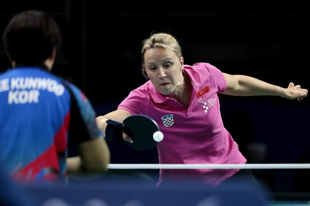 Sandra Paovic of Croatia in action against Kunwoo Lee during the prelimimary round of the Women's's Table Tennis at the Rio 2016 Paralympic Games.
