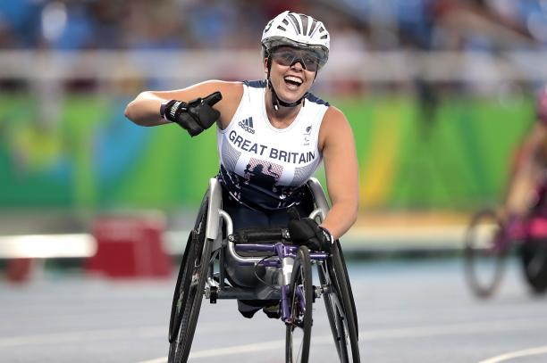 Hannah Cockroft of Great Britain celebrates the victory in the Women's 400m T34 final at Olympic Stadium on day 7 of the Rio 2016 Paralympic Games.