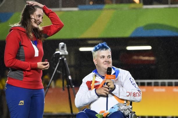 Silver medalist David Drahoninsky of the Czech Republic proposes to his girlfried Lida Fikarova after the medal ceremony for the men's individual archery W1 final atthe Rio 2016 Paralympic Games.