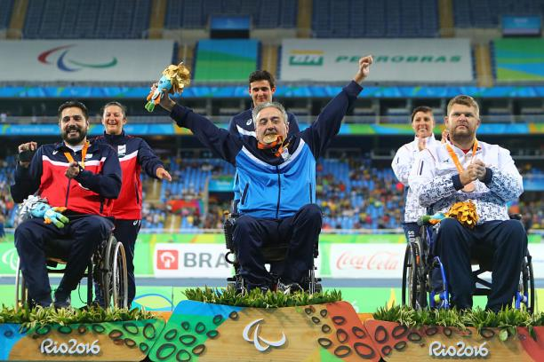 Gold medalist Zeljko Dimitrijevic of Serbia  poses on the podium at the medal ceremony for Men's Club Throw - F51