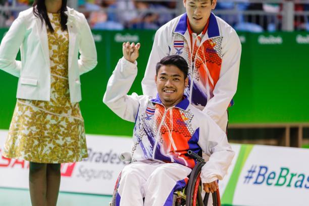 Man in wheelchair celebrating