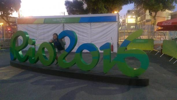 Woman posing in front of Rio 2016 sign